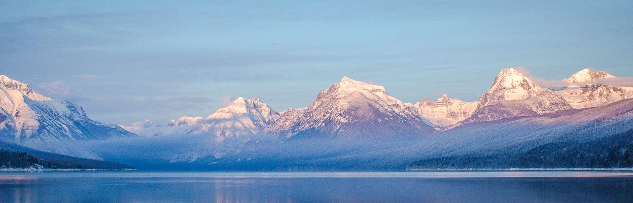 Snow-capped mountains over water