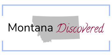 """Montana Discovered logo - """"Montana Discovered"""" written over silhouette of Montana, inside dusty blue rectangle"""