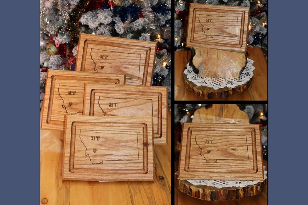 Three photos of wooden cutting boards with the shape of Montana engraved in each one.