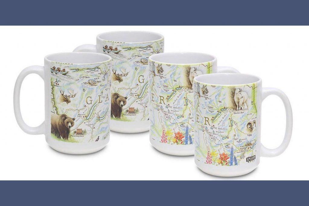 Four ceramic white coffee mugs with hand drawn maps.