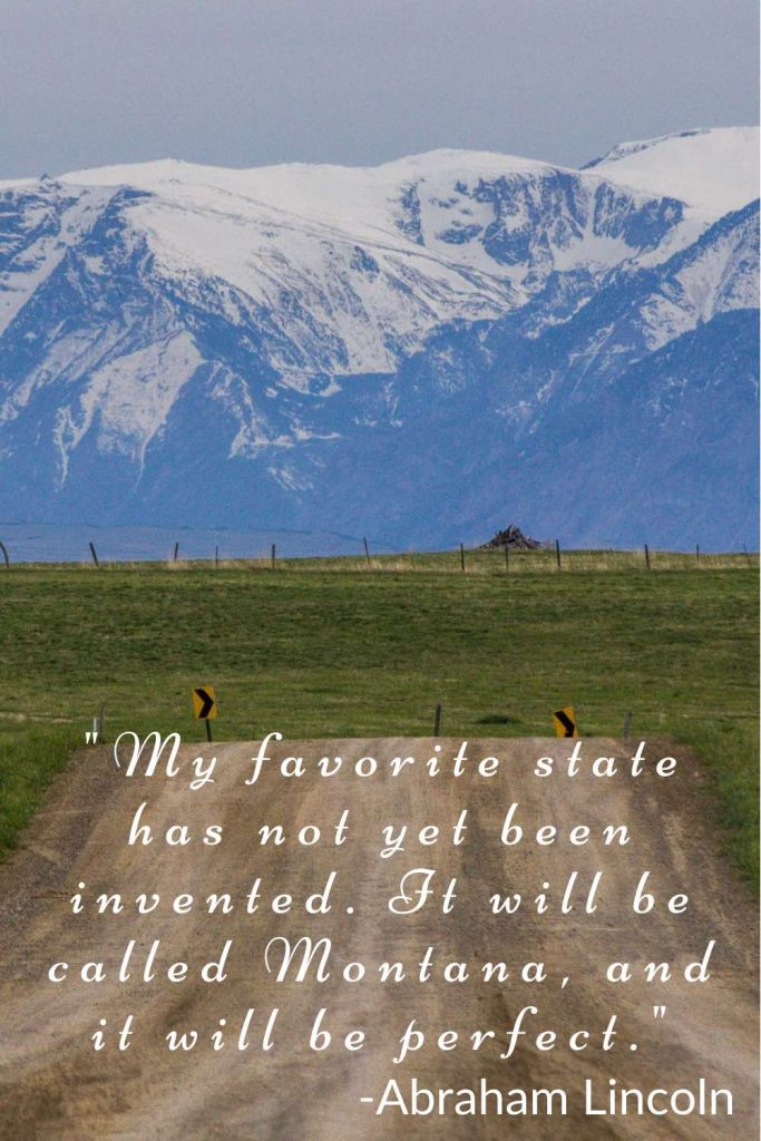 Dirt road through farm field and snowcapped mountains in the background with Abraham Lincoln quote.