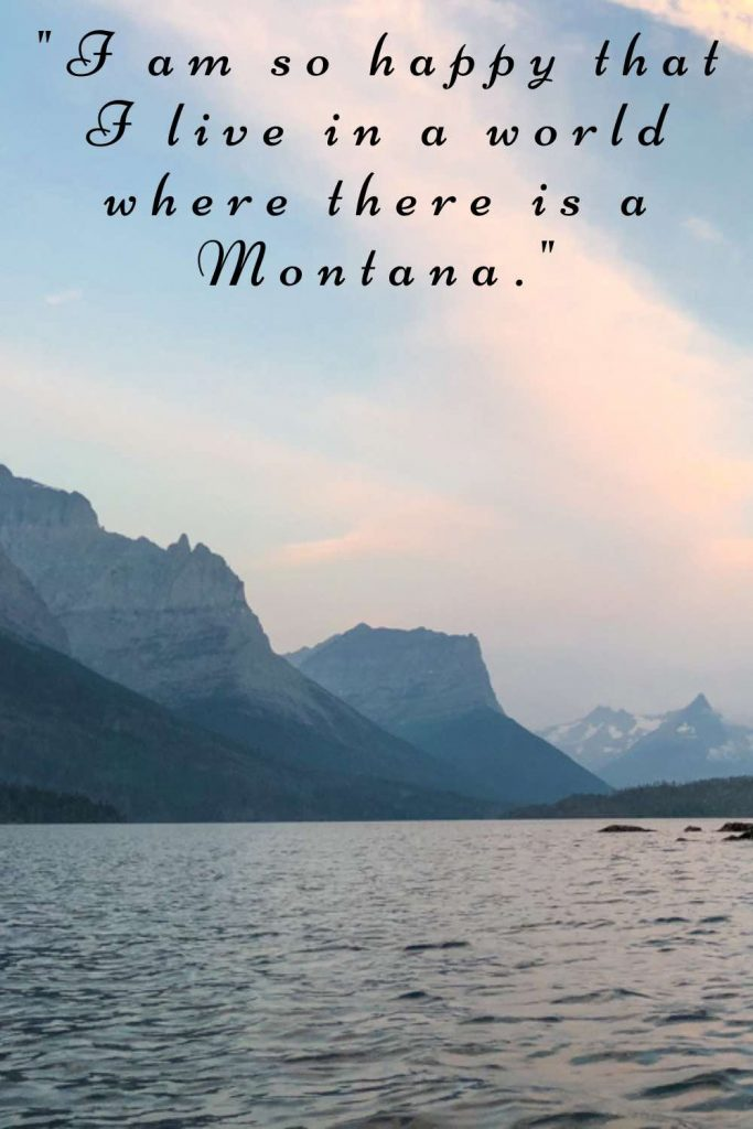 Early morning light shimmering on tranquil lake with Montana quote.
