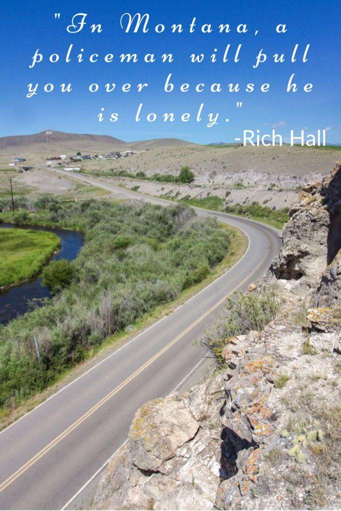 Two-lane highway running through sagebrush prairie with Rich Hall quote.